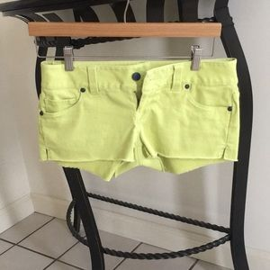 Neon green stretch jean short shorts.